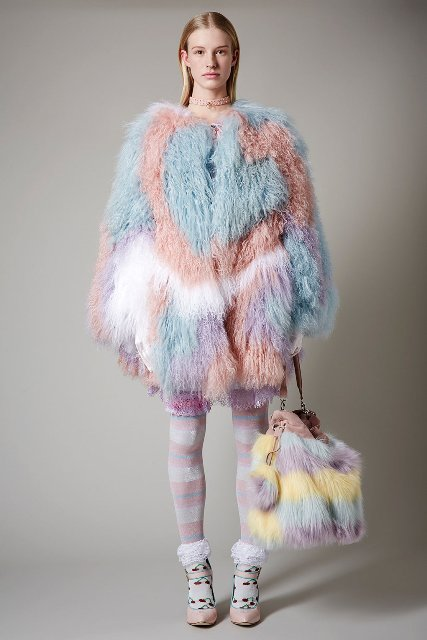 With colorful fur coat, printed tights and light pink shoes