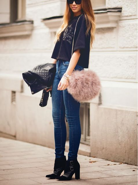 With crop shirt, skinny jeans, leather jacket and ankle boots