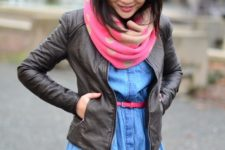 With denim dress, leather jacket and pink belt