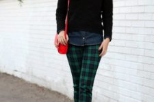 With denim shirt, black sweater, red pumps and red bag