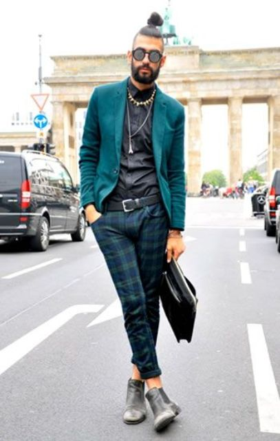 With emerald blazer, black shirt, gray boots and leather bag