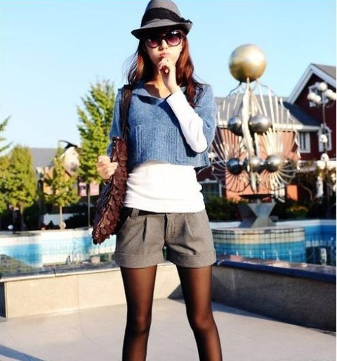 With felt hat, white shirt, blue crop sweater and bag