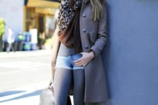 With gray coat, gray tights, brown ankle boots, printed scarf and gray bag
