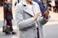 With gray coat, white shirt and jeans