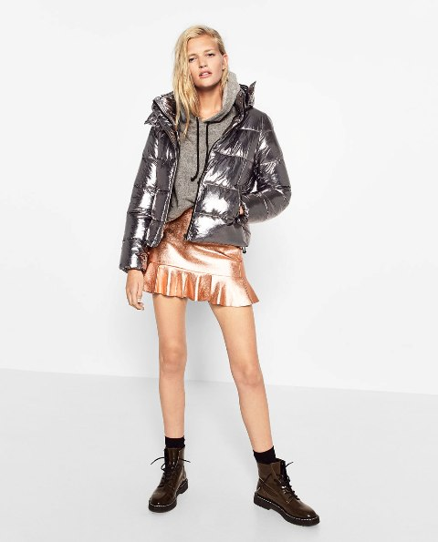 With gray hoodie, metallic skirt and brown boots