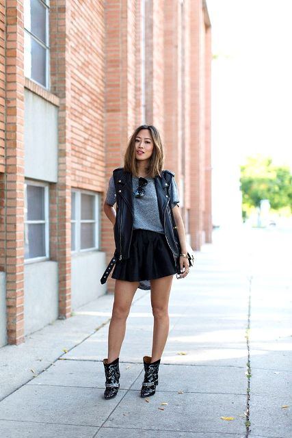With gray shirt, black mini skirt and boots