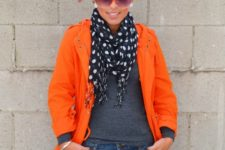 With gray shirt, orange coat and jeans