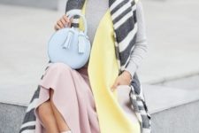 With gray shirt, pale pink skirt, yellow vest, white socks, pale pink shoes and light blue bag