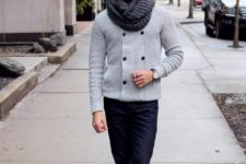 With gray sweater, cuffed jeans and black and white boots