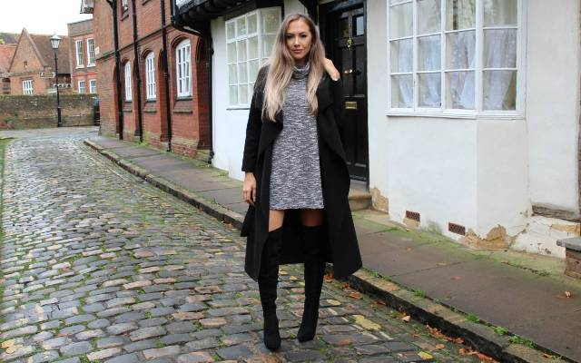 With gray sweater dress and black over the knee boots