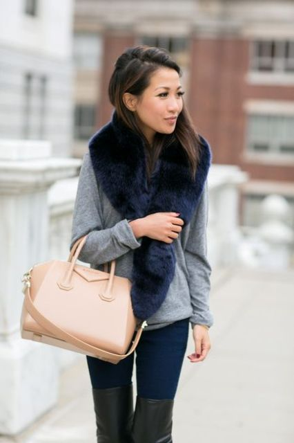 With gray sweatshirt, jeans, over the knee boots and beige bag