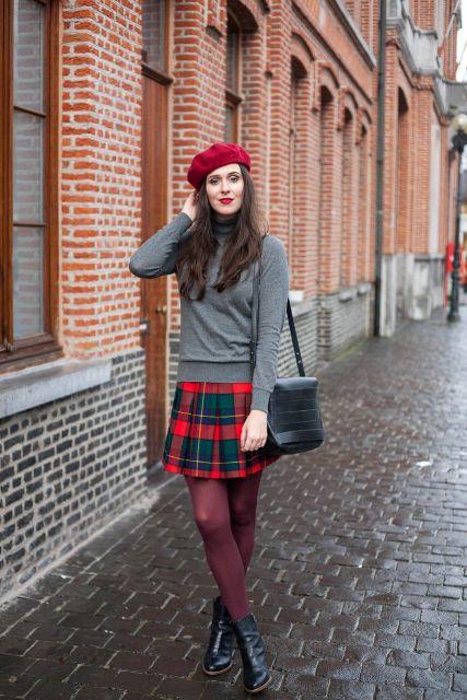With gray turtleneck, marsala tights, ankle boots, red beret and leather bag
