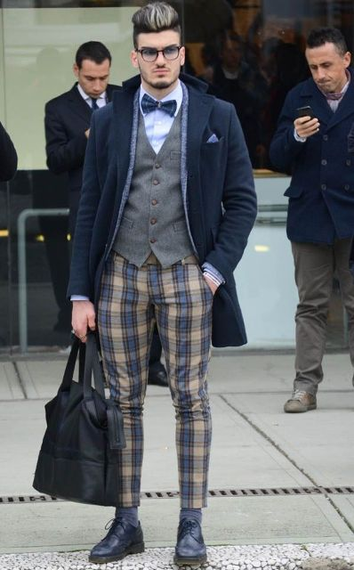 With gray vest, shirt, bow tie, navy blue coat, black shoes and tote
