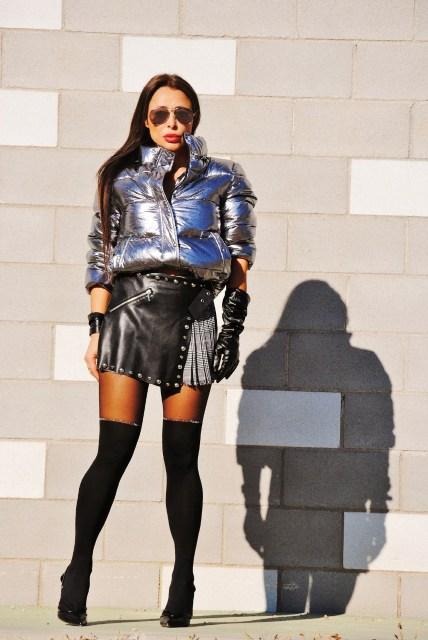 With leather skirt, black heels and black knee socks