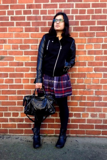 With leather sleeve jacket, ankle boots and black bag