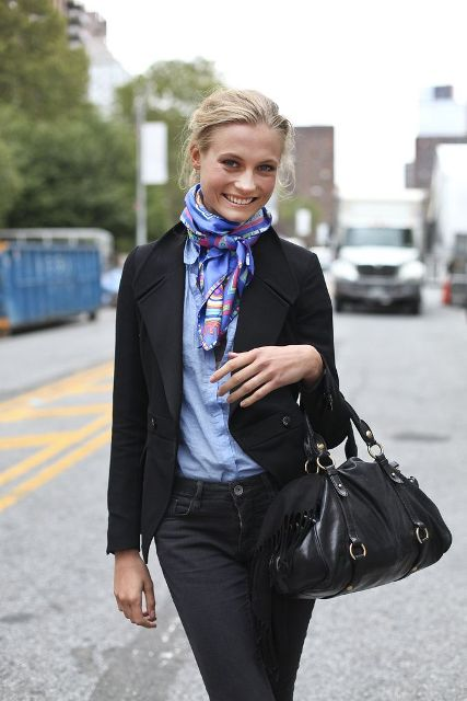 With light blue shirt, black trousers, black jacket and leather bag