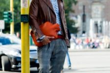 With light blue shirt, bow tie, brown leather jacket and red shoes