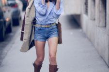 With light blue shirt, brown leather high boots, brown bag and coat