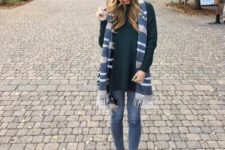 With long sweater, skinny jeans and beige ankle boots