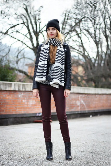 With marsala leather pants, ankle boots, beanie and black leather jacket