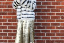 With metallic midi skirt and black ankle boots