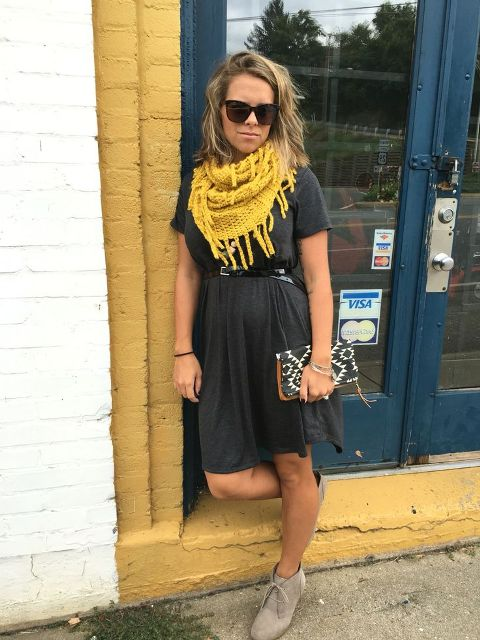 With mini dress, printed clutch and gray suede ankle boots