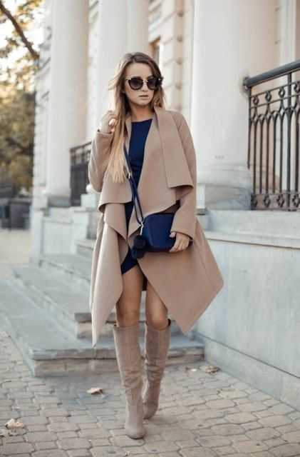 With navy blue dress, navy blue crossbody bag and high boots