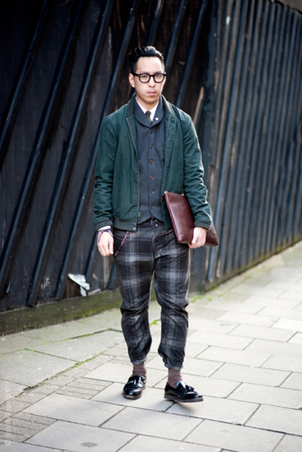 With navy blue jacket, emerald bomber jacket, black shoes and marsala clutch