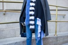 With navy blue shirt, gray coat, jeans and black boots