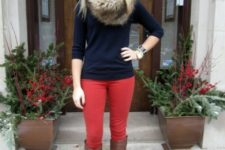 With navy blue shirt, red pants and high boots