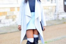 With navy blue sweater, light blue skirt and leather high boots