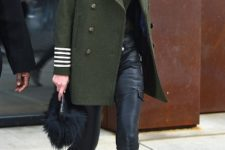 With olive green coat, leather pants and mid calf boots