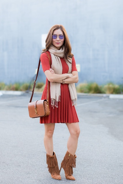 With orange dress, brown fringe boots and brown bag