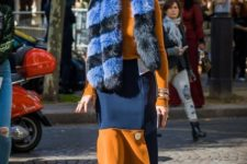 With orange shirt, orange and blue skirt and emerald shoes