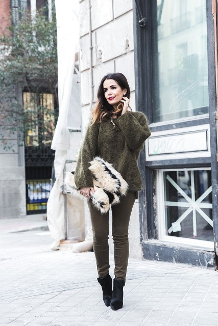 With oversized sweater, skinny pants and platform velvet boots