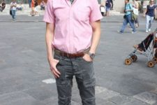 With pale pink shirt, gray pants and gray shoes