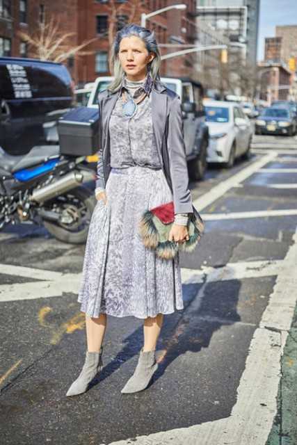 With pastel colored midi dress, blazer and gray boots