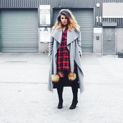 With plaid dress and black boots
