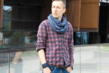 With plaid shirt and jeans