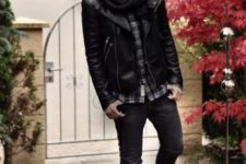With plaid shirt, jeans, lace up boots and leather jacket