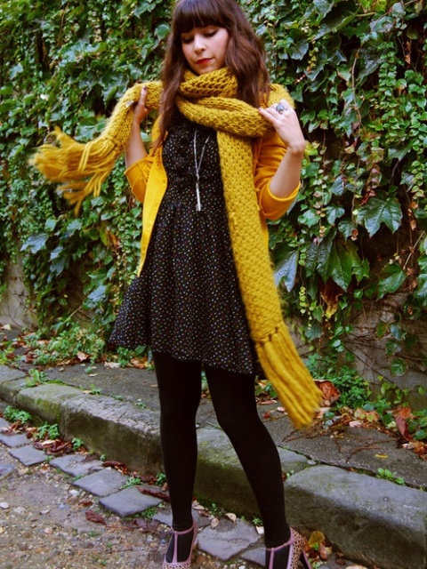 With polka dot dress, black tights, printed shoes and yellow cardigan