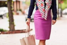 With polka dot shirt, pink pencil skirt, yellow pumps and tote