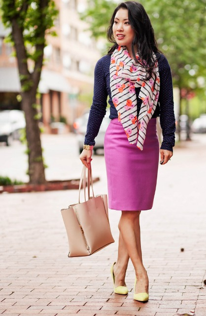With polka dot shirt, pink pencil skirt, yellow pumps and tote