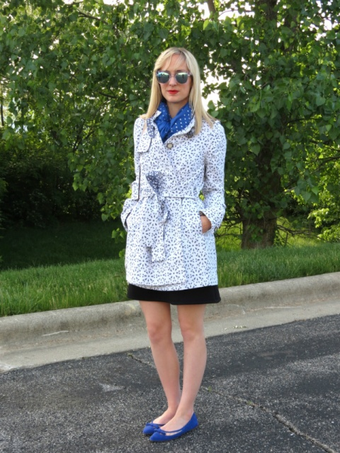 With printed coat, black skirt and blue flats