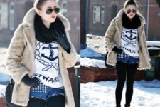 With printed sweatshirt, fur coat, black scarf, lace up boots and black bag