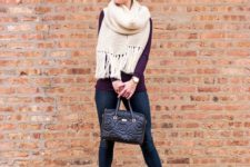 With purple shirt, jeans, ankle boots and black bag