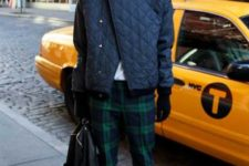 With shirt, navy blue puffer jacket, black boots and backpack