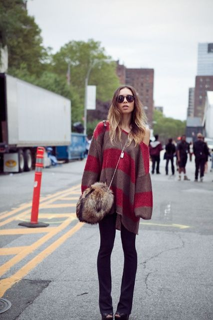 With striped oversized sweater, flare pants and platform shoes