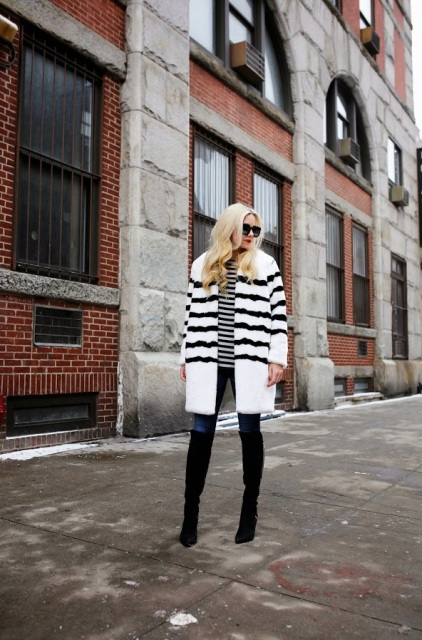 With striped shirt, jeans and over the knee boots