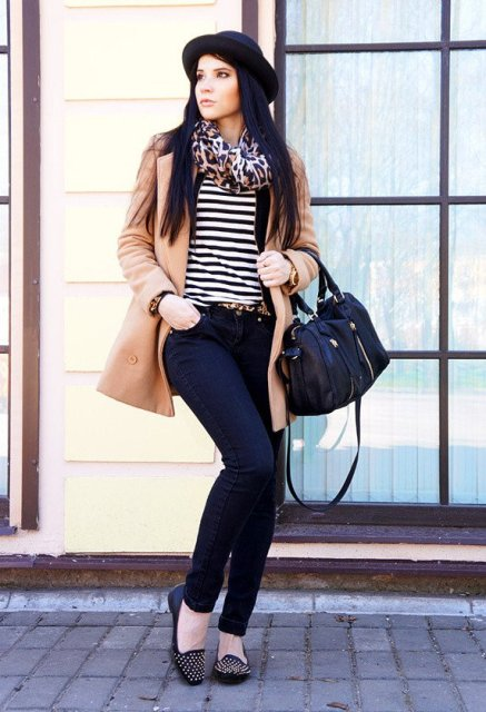 With striped shirt, jeans, embellished flats, camel coat and black hat